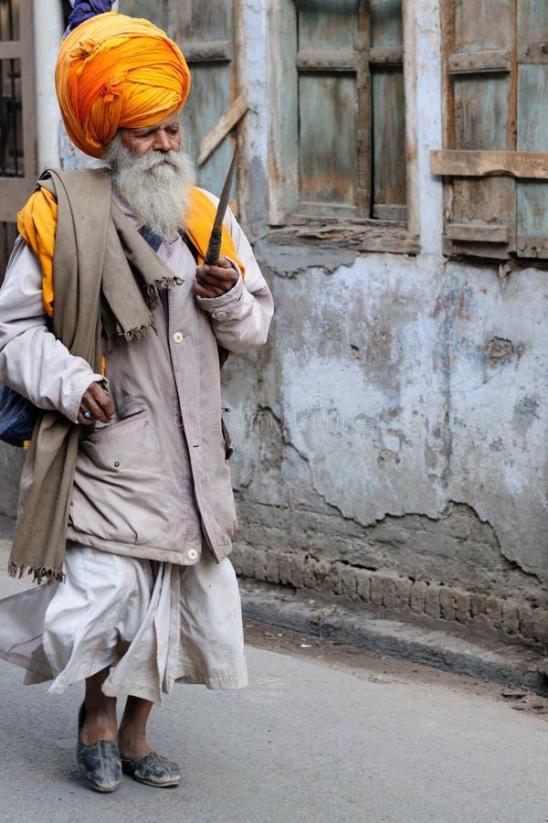 Pilgrim in India. INDIA, AMRITSAR - NOVEMBER 30: Pilgrim aiming at the Golden temple (Sri Harimandir Sahib), Amritsar in November 30, 2009 royalty free stock photo