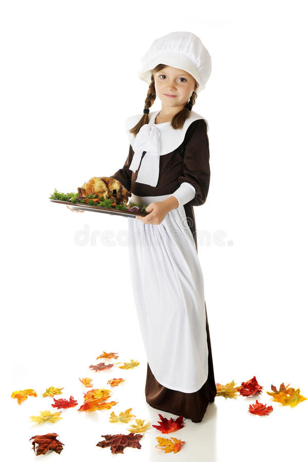 Pilgrim Serving Thanksgiving Dinner royalty free stock image