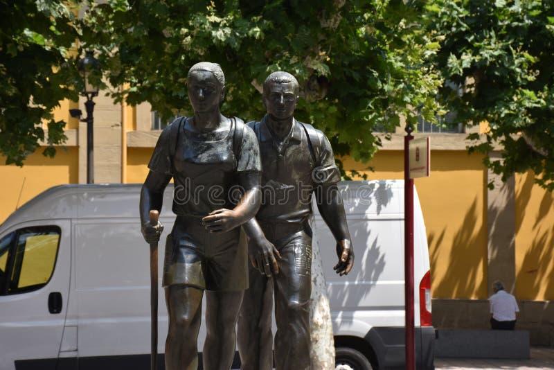 Pilgrim statue in Logrono Spain along the Camino de Santiago. This life size statue in Logrono Spain reflects two pilgrims walking along the Camino de Santiago royalty free stock photo