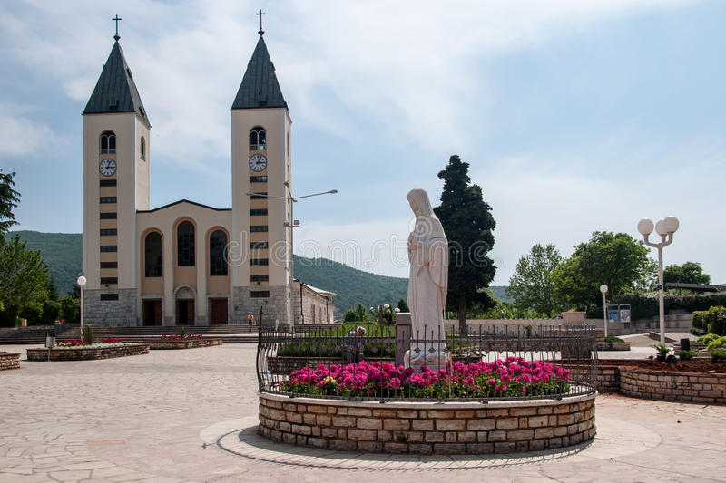 Pilgrimage church in Medjugorje. Pilgrimage church and Virgin Mary statue in Medjugorje, Bosnia and Herzegovina royalty free stock photo