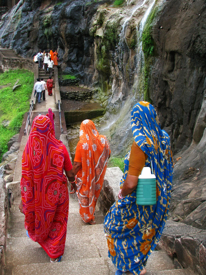 Pilgrims at Ajanta: amazing old buddhist temples royalty free stock images