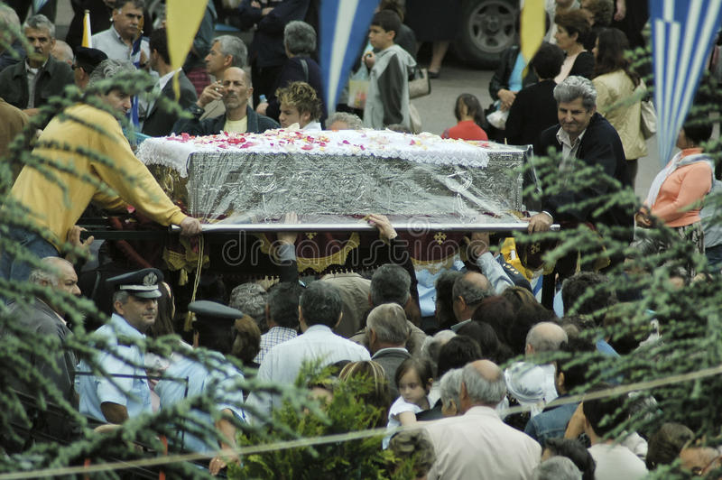Pilgrims from around the world passing under the coffin with relics of St. John the Russian stock photos