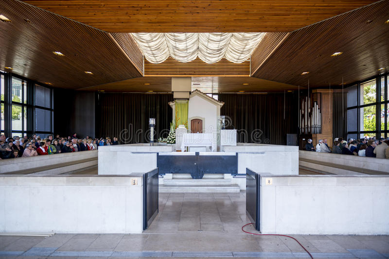 Pilgrims at the Chapel of the Apparitions at the Sanctuary of Fatima during the celebrations of the apparition of the Virgin Mary royalty free stock photo