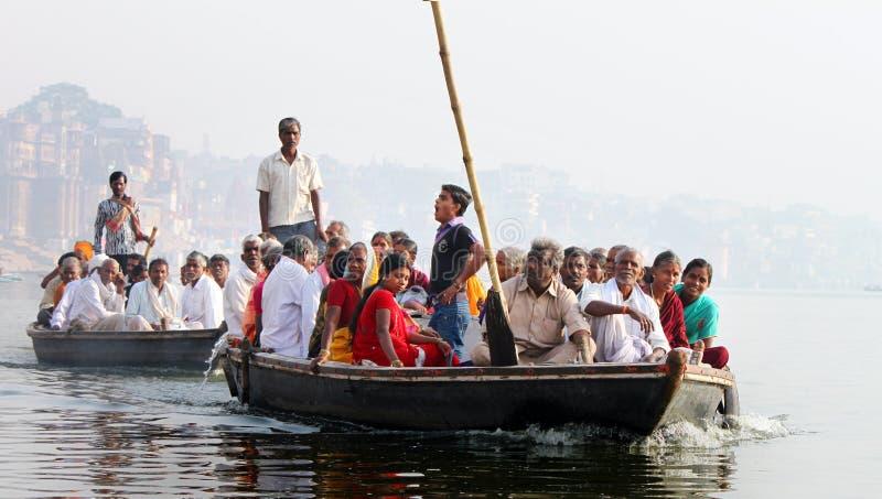 Pilgrims Crossing river Ganga by boats