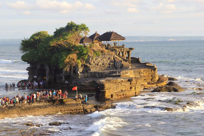 Pilgrims enjoy sunset at Tanah Lot temple,Bali, Indonesia stock photo
