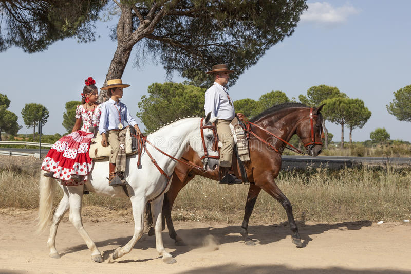 Pilgrims on horseback in El Rocio, Spain. El Rocio, Spain - June 1, 2017: Pilgrims on horseback in traditional spanish dress on the road to El Rocio during the royalty free stock image