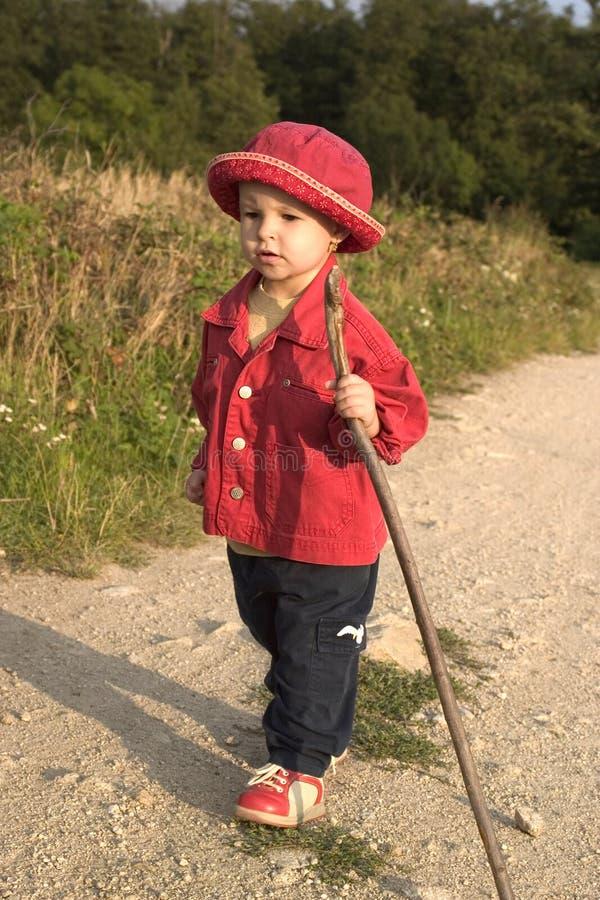 Pilgrims of the little girl. Walking royalty free stock photo