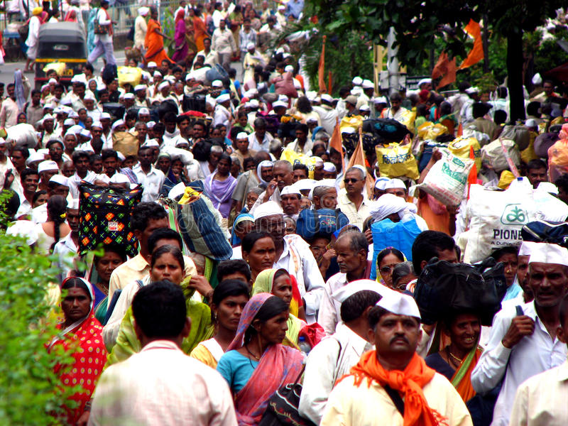 Pilgrims Migration. Thousands of hindu pilgrims Warkari`s migrate through the city of Pune - India, to the famous pilgrimmage festival royalty free stock photos