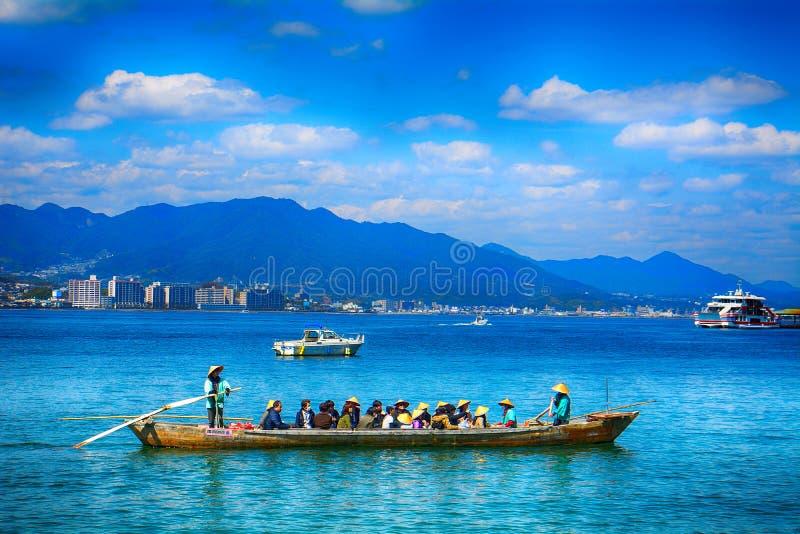 Pilgrims, Miyajima, Japan royalty free stock photos