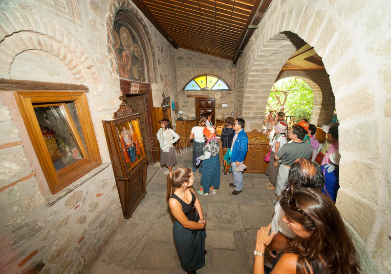 Pilgrims in a monastery in Meteora. Greece royalty free stock image