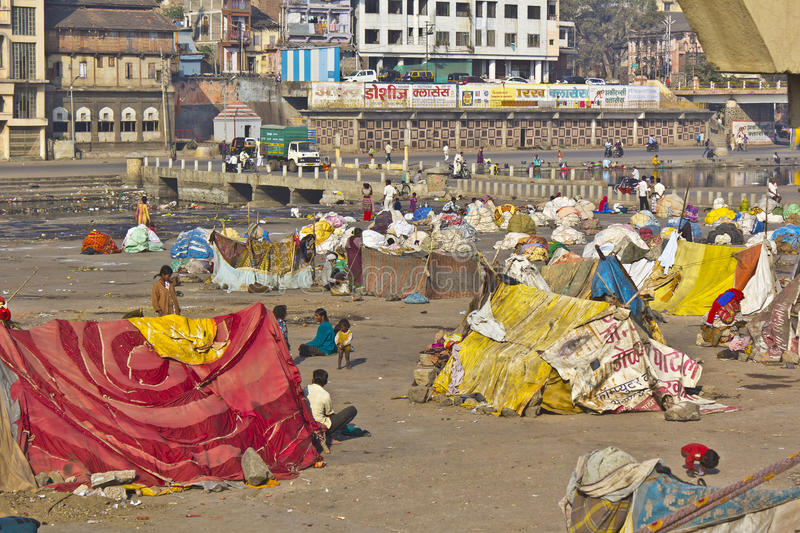 Pilgrims in Nashik. FEB 6, 2015, NASHIK, INDIA - Camp of Hindu pilgrims on the bank of the sacred river Godavari royalty free stock photos