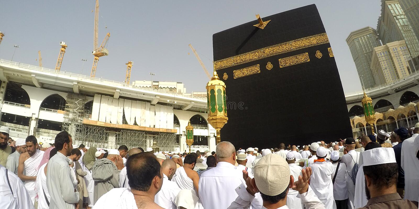 Pilgrims perform the Tawaf and Prayer. MECCA, SAUDI ARABIA, 13 April 2017 - Muslim pilgrims from all over the world gathered to perform Umrah or Hajj at the royalty free stock images