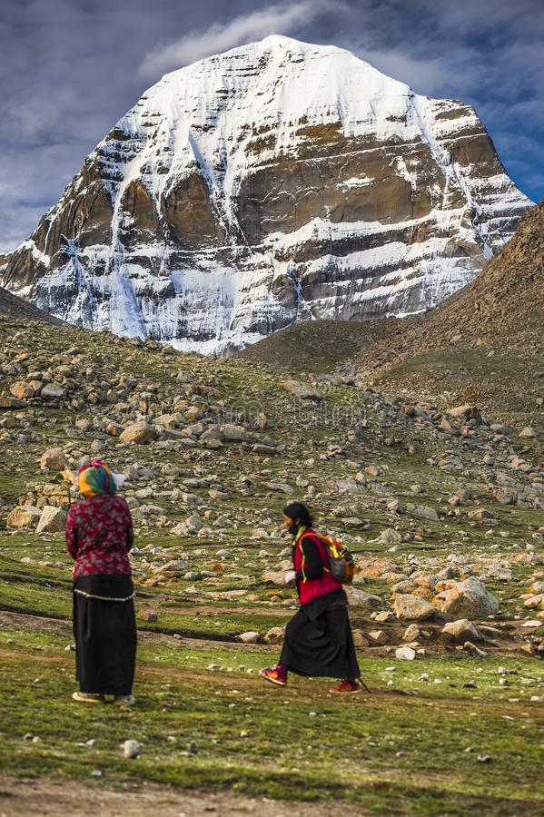 Pilgrims pray in front of Mt Kailash , Kang Rinpoche , holy mountain , Tibet stock photography