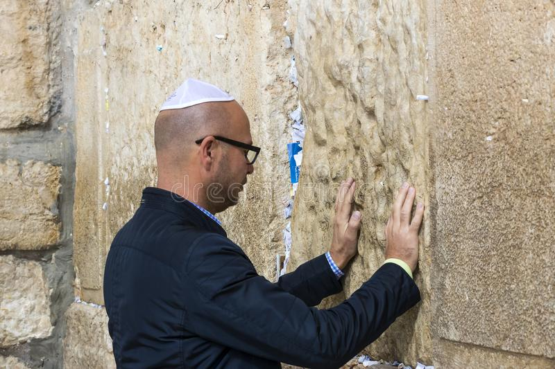 Pilgrims pray at the wall of the weeping of the holy place of the Jewish people and the center of worship of Christians around the. JERUSALEM, ISRAEL - 22 stock photo