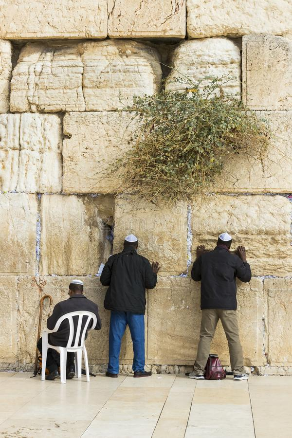 Pilgrims pray at the wall of the weeping of the holy place of the Jewish people and the center of worship of Christians around the. JERUSALEM, ISRAEL - 22 stock photography