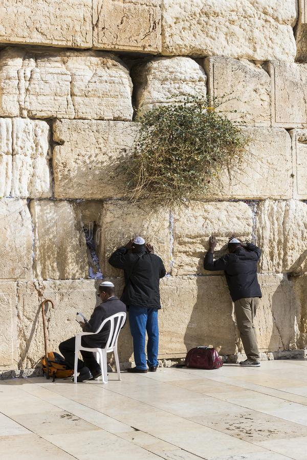 Pilgrims pray at the wall of the weeping of the holy place of the Jewish people and the center of worship of Christians around the. JERUSALEM, ISRAEL - 22 stock image