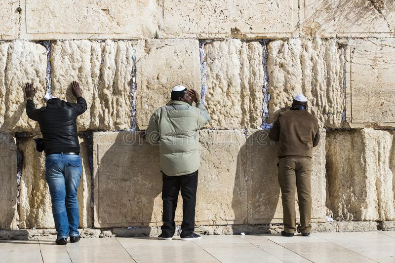 Pilgrims pray at the wall of the weeping of the holy place of the Jewish people and the center of worship of Christians around the stock photos