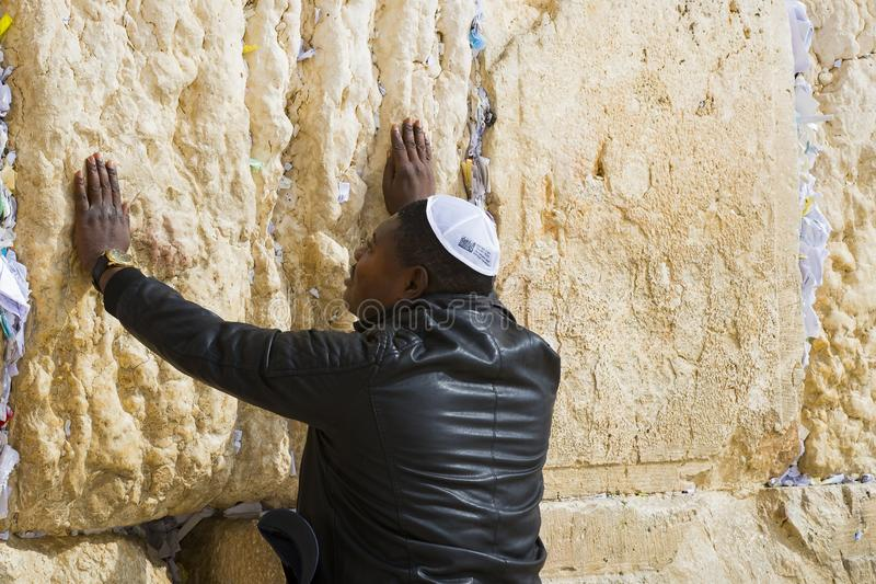 Pilgrims pray at the wall of the weeping of the holy place of the Jewish people and the center of worship of Christians around the royalty free stock image