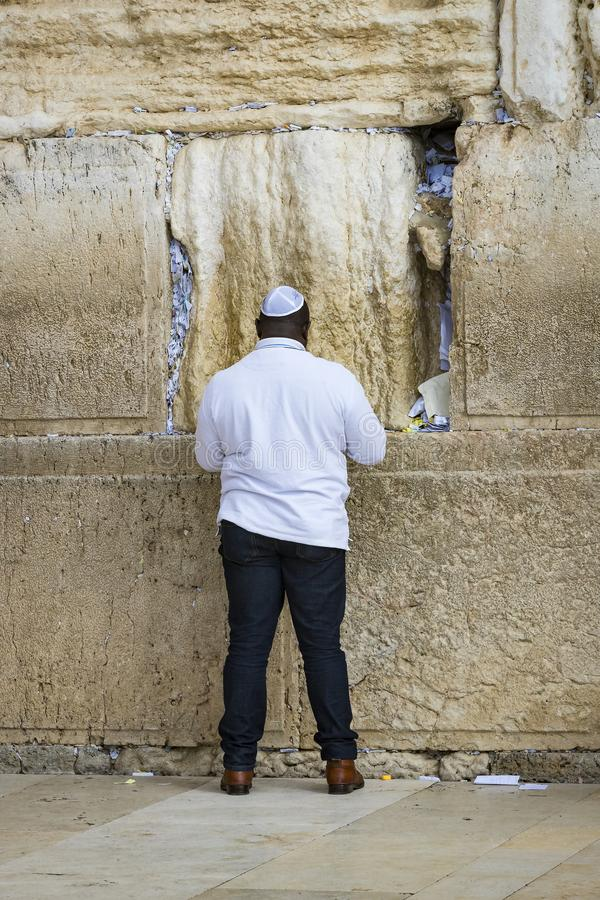 Pilgrims pray at the wall of the weeping of the holy place of the Jewish people and the center of worship of Christians around the royalty free stock photography