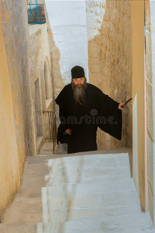 Pilgrims. A priest in the Greek Orthodox monastery in the West Bank of the Jordan River, in the Judean desert, in the Kidron Valley stock photography
