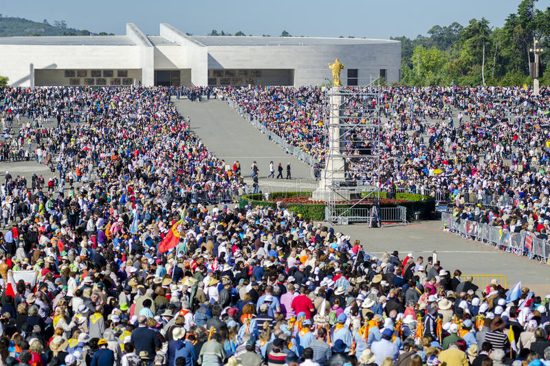 Pilgrims at the Sanctuary of Fatima during the celebrations of the apparition of the Virgin Mary in Fatima, Portugal. Fatima, Portugal - May 13, 2014: Pilgrims stock images