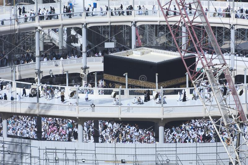 Pilgrims Tawaf Around Al-Kaaba While Construction Works Are Going on at Al Haram in Mecca royalty free stock image