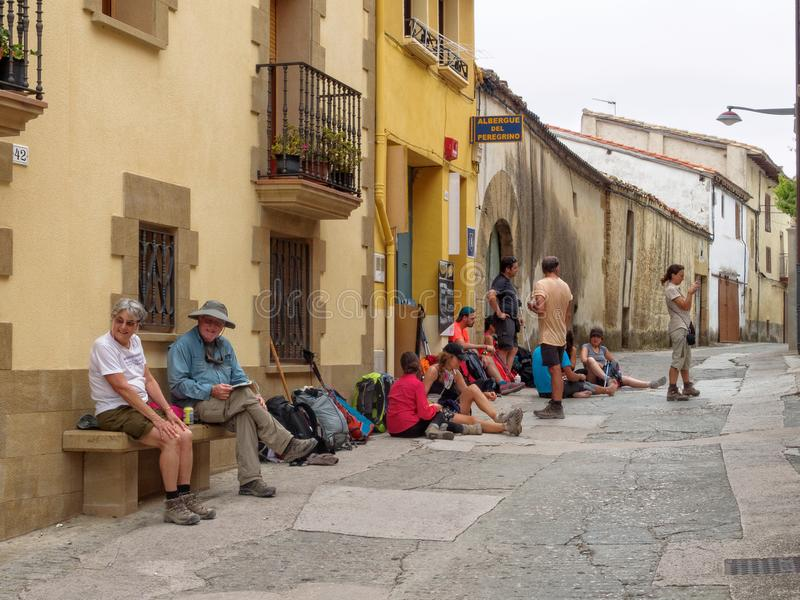 Pilgrims at Albergue de Lorca. Pilgrims wait for the afternoon opening of their hostel - Lorca, Navarre, Spain, 6 September 2014 royalty free stock images