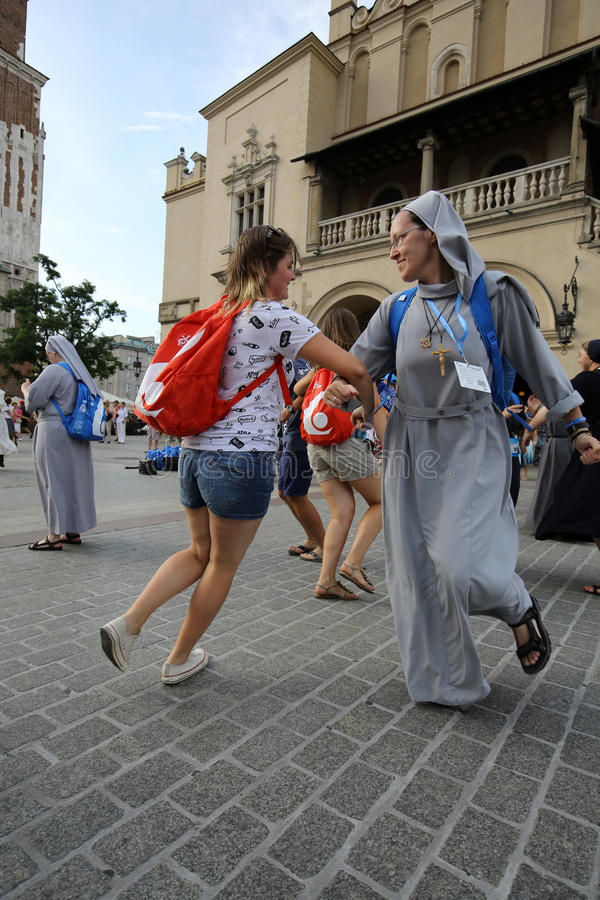 Pilgrims of World Youth Day sing and dance on the Main Square in Cracow. Poland stock image