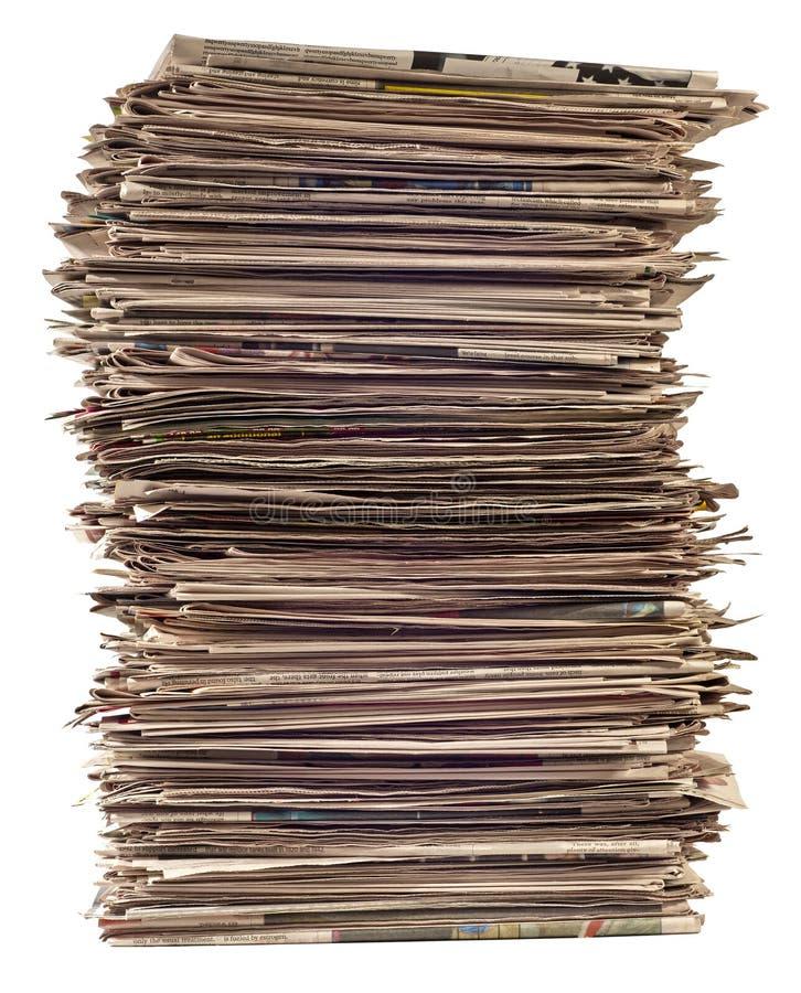 Pilha alta revisão dos jornais de ?a fotografia de stock royalty free