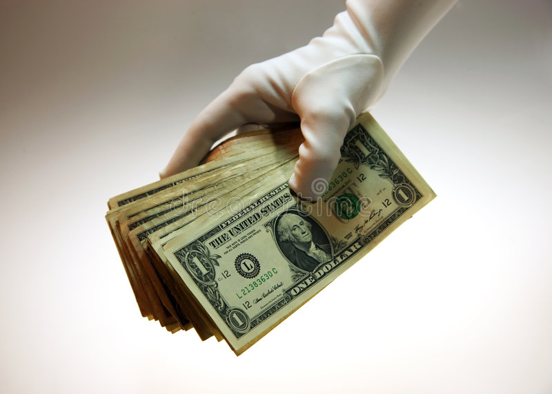 Pilha branca da luva de dinheiro imagem de stock royalty free