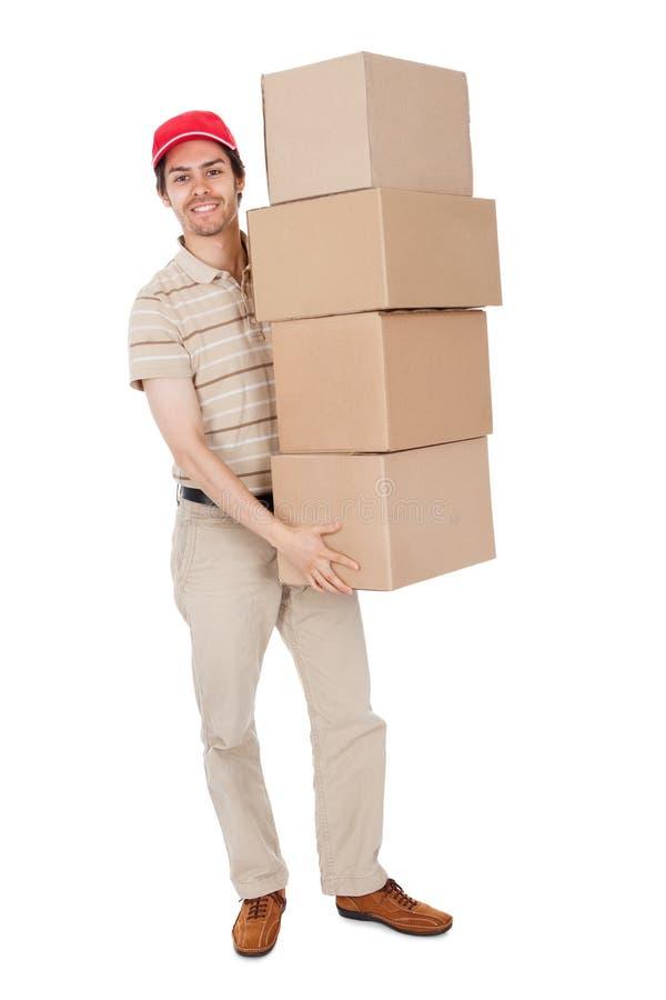 Pilha carreg do homem de entrega de caixas imagem de stock