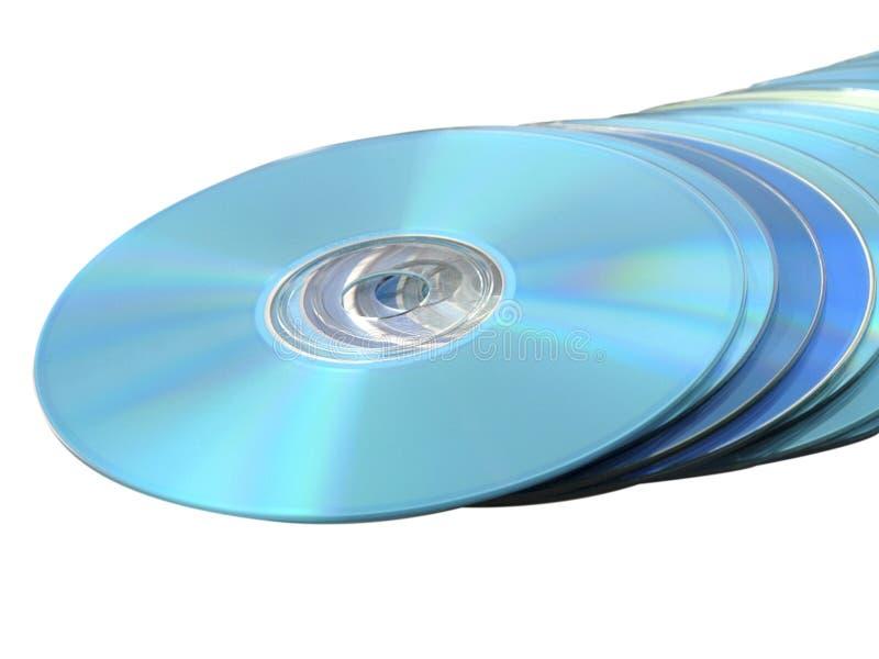 Pilha da Azul-raia de DVDs dos Cd de discos no branco imagens de stock