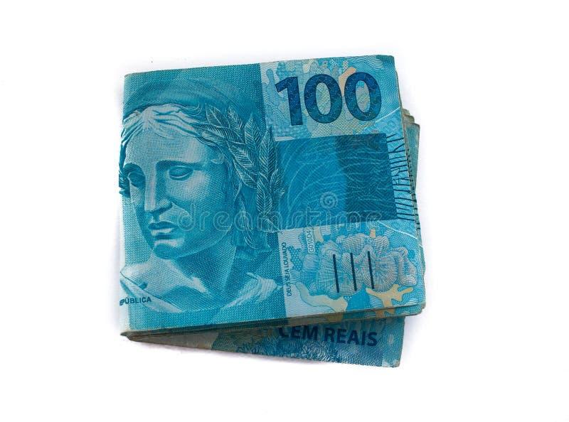 Pilha da moeda do brasileiro 100 foto de stock