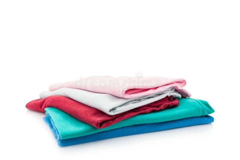 Pilha da roupa colorida isolada no fundo branco fotos de stock royalty free