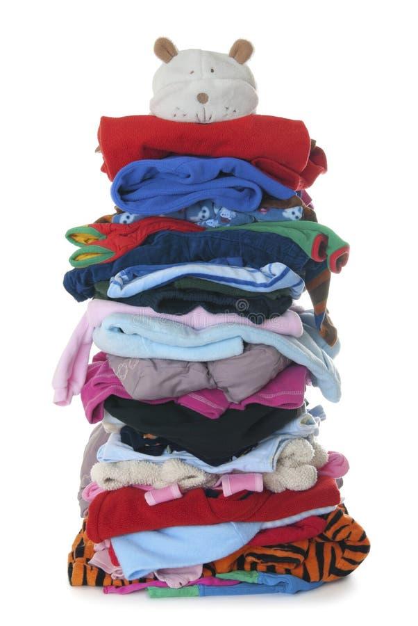 A pilha das crianças aquece a roupa macia | Isolado imagem de stock