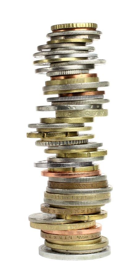 Pilha das moedas do mundo fotografia de stock