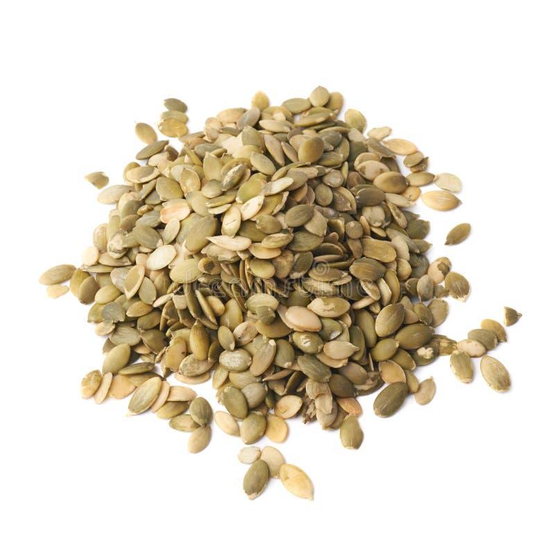 Pilha das sementes de abóbora isoladas fotografia de stock royalty free