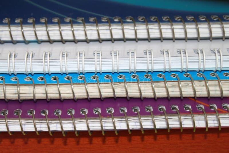 Pilha de cadernos da bobina imagem de stock