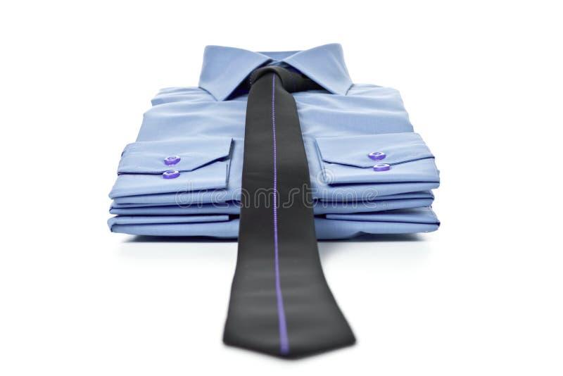 Pilha de camisas azuis imagem de stock royalty free