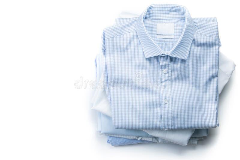 Pilha de camisas dobradas homem isoladas imagens de stock