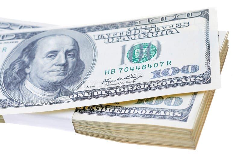 Pilha de cem dólares isolados no branco fotos de stock royalty free