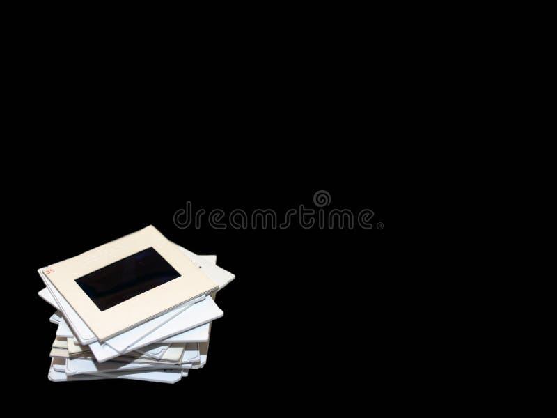 Pilha de corrediças no preto imagens de stock