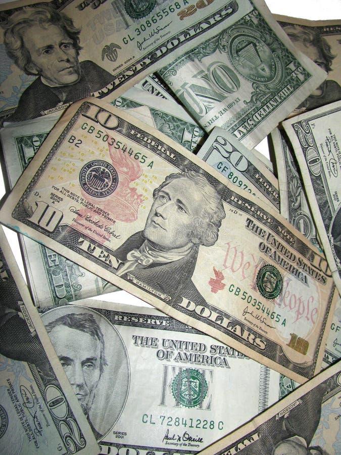 Pilha de dólares americanos No branco imagens de stock
