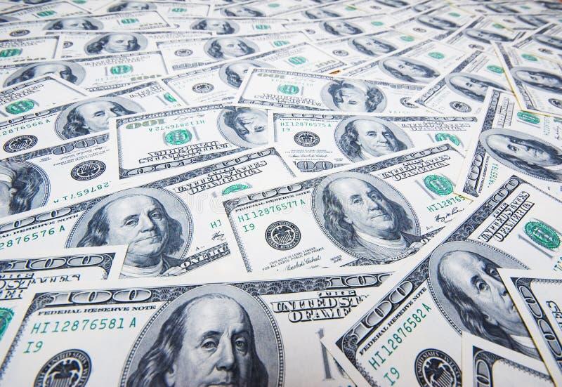 Pilha de dólares como o fundo imagem de stock royalty free