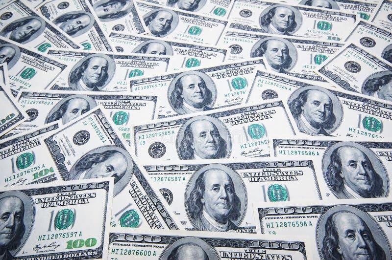 Pilha de dólares no dinheiro imagem de stock royalty free