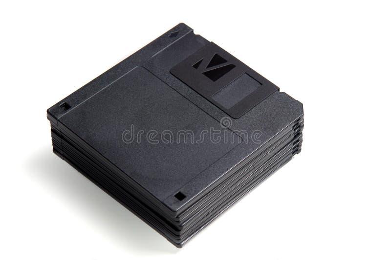 Pilha de disquetes velhas do formato isoladas no fundo branco fotos de stock