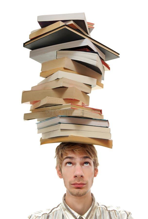 Pilha de equilíbrio de livros na cabeça imagem de stock royalty free