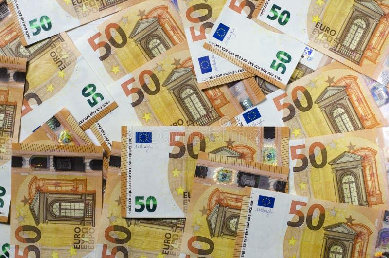 Pilha de 50 euro- notas Muitas cédulas euro- foto de stock