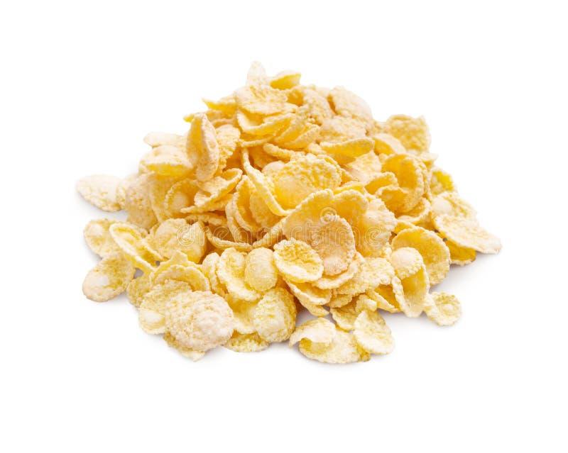 Pilha de flocos de milho no fundo branco fotografia de stock