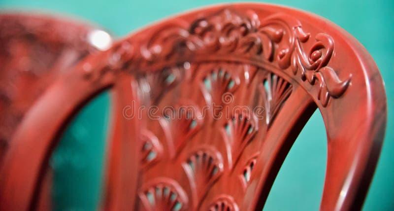 Pilha de foto plástica vermelha das cadeiras fotos de stock royalty free